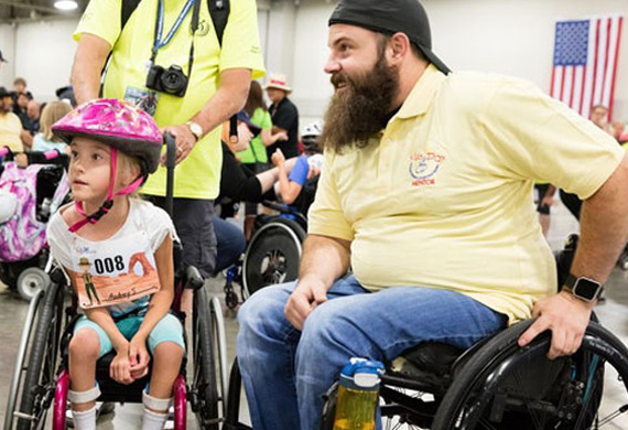 image of Dan Rose talking with disable girl in a wheelchair