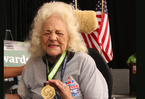 image of Doris Merrill shows her wheelchair games medal