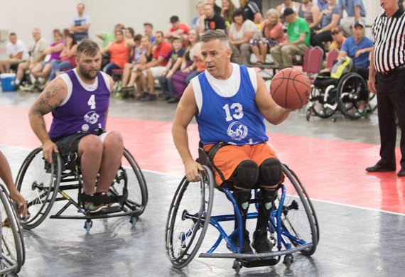 Image of Jimmy Green playing wheelchair basketball