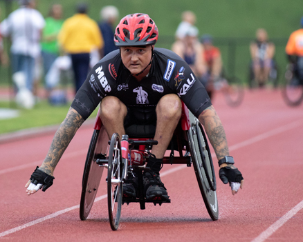 image disabled man racing in a wheelchair