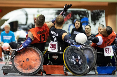 image of disabled athletes in wheelchairs playing volleyball